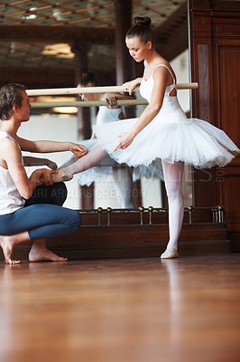 Buy stock photo Portrait of a young male ballet trainer training a female ballet dancer