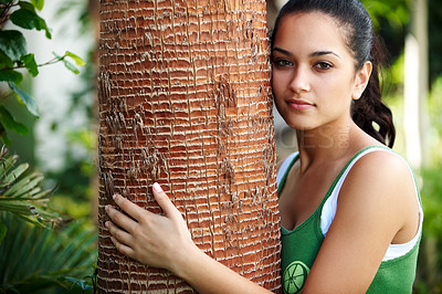 Buy stock photo Portrait of cute young woman embracing a big tree - Nature love