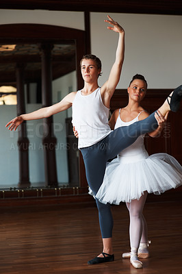 Buy stock photo Portrait of two young ballet dancers practicing