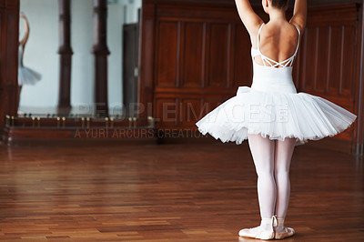 Buy stock photo Rear view of a ballerina dancing in front of a mirror