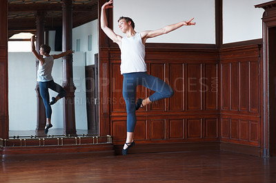 Buy stock photo Full length of a male ballet dancer practicing in front of a mirror