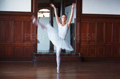 Buy stock photo Blurred motion of a young ballerina dancing in front of a mirror