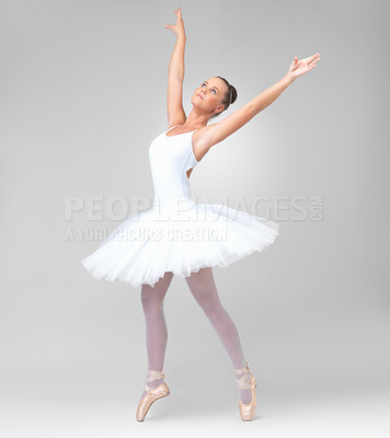 Buy stock photo Full length of a young and cute ballerina dancing against white background - copyspace