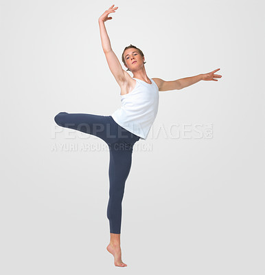 Buy stock photo Full length of a male ballet dancer practicing gracefully against white background