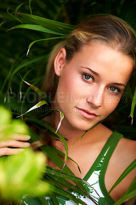 Buy stock photo Closeup portrait of an attractive woman among leaves in a park - Outdoor