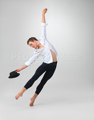 Buy stock photo Full length of a stylish male dancer performing against white background - copyspace