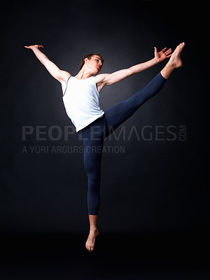 Buy stock photo Full length of a male ballet dancer posing against black background - copyspace