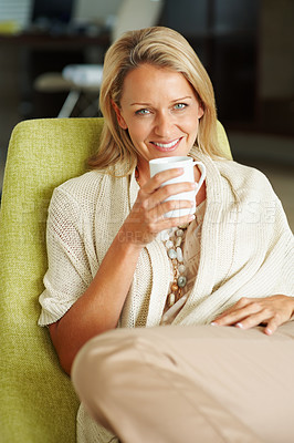 Buy stock photo Closeup portrait of a relaxed mature woman with a cup of coffee