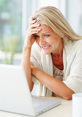 Buy stock photo Portrait of a beautiful business woman reading bad news on laptop