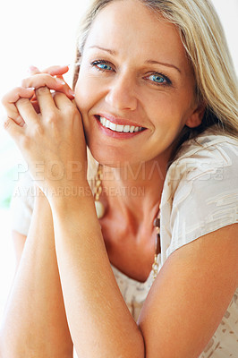 Buy stock photo Portrait of a relaxed blue eyed woman smiling , hands clasped