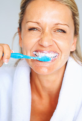 Buy stock photo Detail portrait of a happy mature woman brushing her teeth