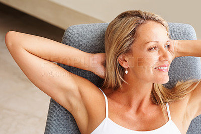 Buy stock photo Closeup portrait of a relaxed mature woman looking away in thought