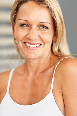 Buy stock photo Closeup of an attractive happy mid adult woman smiling