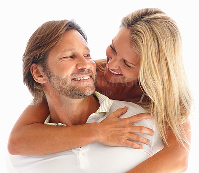 Buy stock photo Closeup of a loving man giving woman piggyback ride against white background