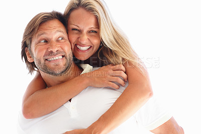 Buy stock photo Happy mature female enjoying a piggyback ride on man's back against white