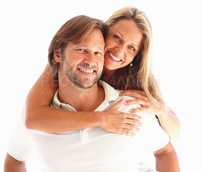 Buy stock photo Closeup of a loving man carrying a woman on his back against white background