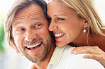 A romantic cheerful mature man and woman smiling