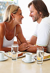 Loving mature couple looking at each other during breakfast