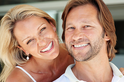 Buy stock photo Closeup portrait of a happy mature man and woman smiling together