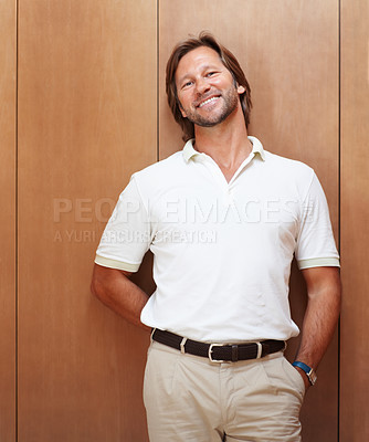 Buy stock photo Portrait of a man smiling against wooden background