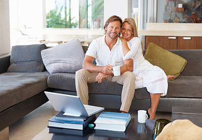 Buy stock photo Cute and happy mature couple sitting together comfortable at home