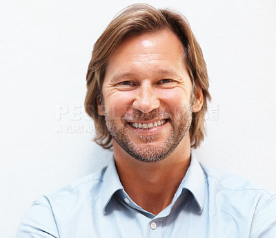 Buy stock photo Closeup portrait of a happy mature man smiling against white background