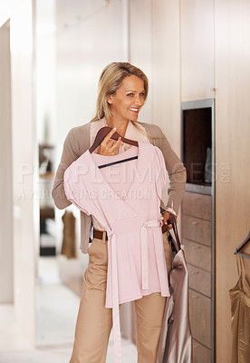 Buy stock photo Happy mature woman selecting what can to dress at home