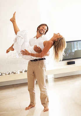 Buy stock photo Full length of a loving happy mature man carrying a woman in his arms