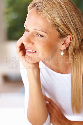 Buy stock photo Closeup portrait of a thoughtful beautiful mature woman looking away with hand on chin