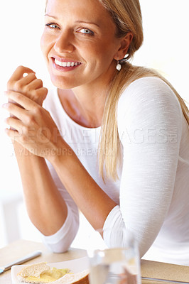 Buy stock photo Closeup portrait of a smiling attractive mature woman sitting at breakfast table