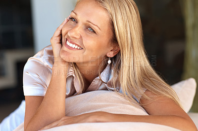 Buy stock photo Portrait of a beautiful relaxed mature woman smiling in thought