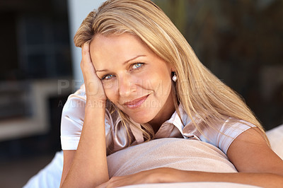 Buy stock photo Closeup portrait of an attractive relaxed mature woman smiling
