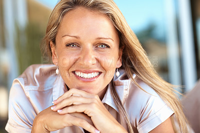 Buy stock photo Closeup portrait of a happy mid adult woman with hands on chin