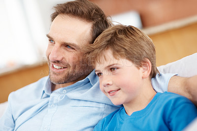 Buy stock photo Closeup portrait of a happy young father with his son looking away - Indoor