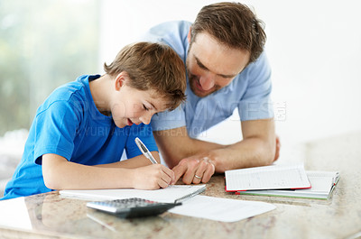 Buy stock photo Portrait of a father helping his son with his schoolwork - Indoor