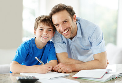 Buy stock photo Portrait of a happy young father with his son studying - Indoor