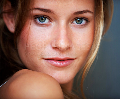 Buy stock photo Closeup portrait of gorgeous young woman posing confidently against grey background