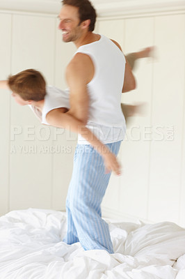 Buy stock photo Portrait of a happy young man playing with a small boy