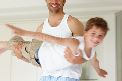 Buy stock photo Portrait of a happy small boy playing with his father, pretending to fly - copyspace
