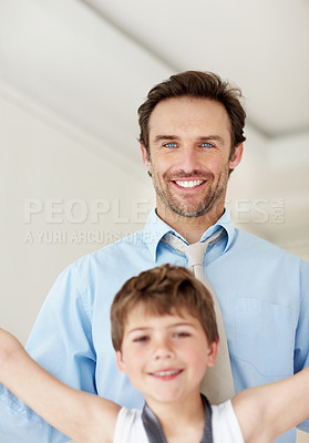Buy stock photo Portrait of a happy young man and his little child having fun together