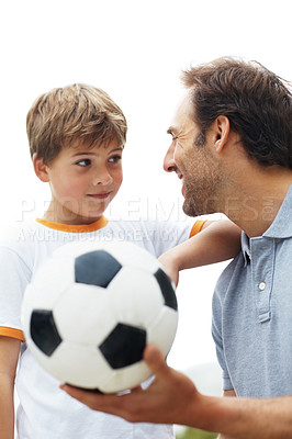 Buy stock photo Portrait of a small young boy looking at his father holding football