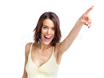 Buy stock photo Portrait of a happy young woman pointing towards copyspace against white background