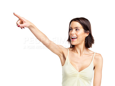 Buy stock photo Portrait of a lovely young female pointing at copyspace against white background
