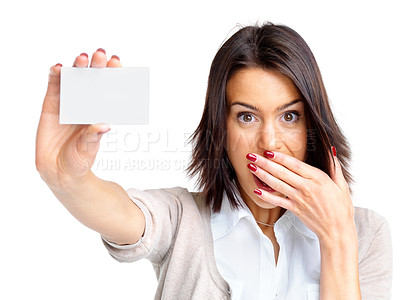 Buy stock photo Portrait of a surprised young woman holding a small blank card against white background
