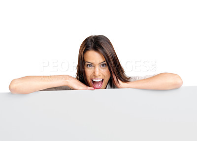 Buy stock photo Portrait of excited young woman leaning on a empty white board