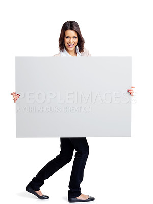 Buy stock photo Full length portrait of a happy young female holding an empty bill board over white background