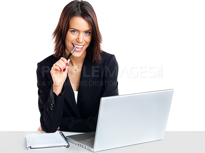 Buy stock photo Portrait of a pretty young businesswoman at the office desk holding a pen against white background