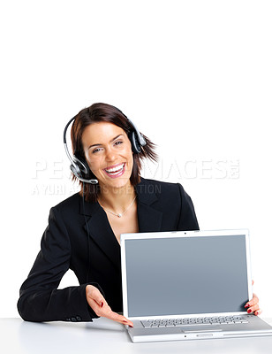 Buy stock photo Portrait of a happy young businesswoman with headset showing a laptop against white background