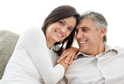 Buy stock photo Portrait of a happy mature couple sitting together on couch