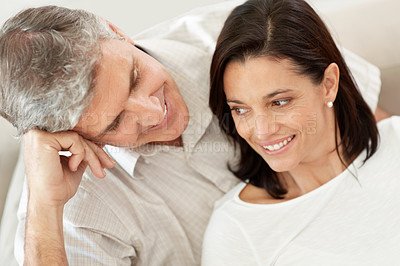 Buy stock photo Portrait of a mature man looking at his beautiful wife and smiling